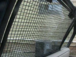 Inside view of the installed BreezeGuard car window screens.