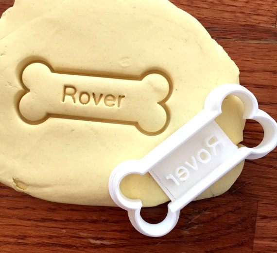 Pet Faves | Personalized Dog Treat Cookie Cutter | The way through to a dog parent's heart is through their dog's stomach. And the way to a dog's stomach is treats especially treats with their name on them! Adding a personalized dog treat cookie cutter to a dog treat recipe jar gift will win over both pet parent and dog.