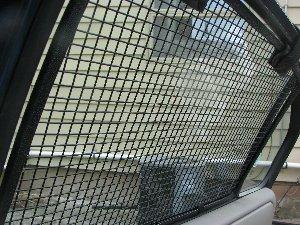 Inside view of the installed BreezeGuard car window screens.