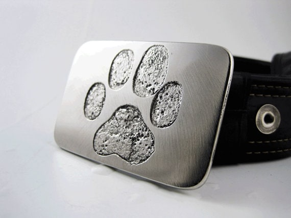 Add a little style to your favorite dog dad's wardrobe with this beautiful etched stainless steel dog paw belt buckle.